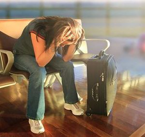 -92-woman stuck_in_airport_overbooking_flight_cancelled_680